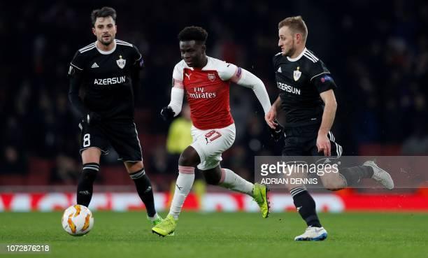 Arsenal's English striker Bukayo Saka vies with Qarabag's Azerbaijan defender Maksim Medvedev during their UEFA Europa league Group E football match...