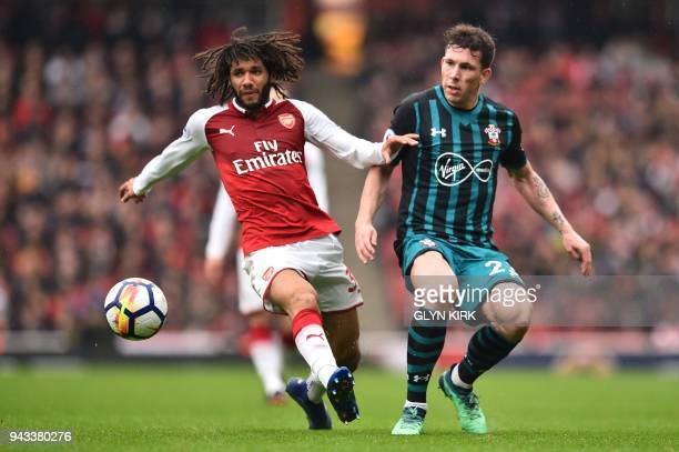 Arsenal's English striker Chuba Akpom vies with Southampton's Danish midfielder PierreEmile Hojbjerg during the English Premier League football match...