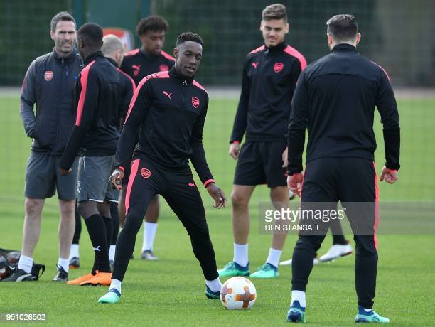 Arsenal's English striker Danny Welbeck attends a training session on the eve of their Europa League first leg semifinal football match against...