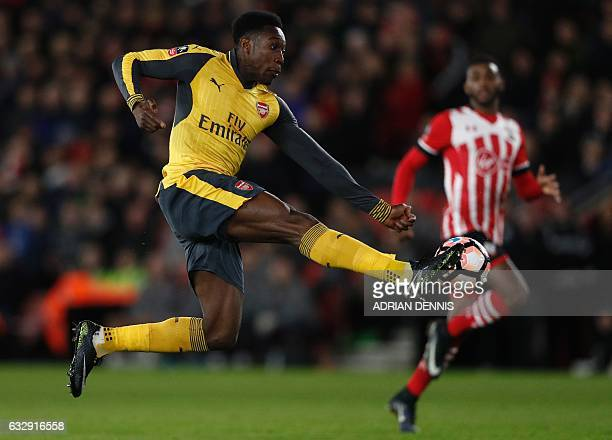 Arsenal's English striker Danny Welbeck scores his team's second goal during the English FA Cup fourth round football match between Southampton and...