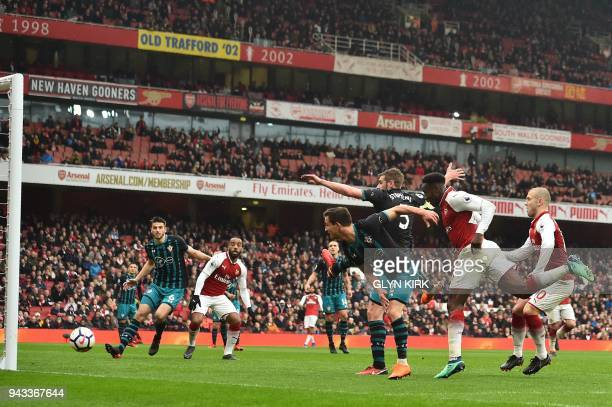 Arsenal's English striker Danny Welbeck scores the team's third goal during the English Premier League football match between Arsenal and Southampton...