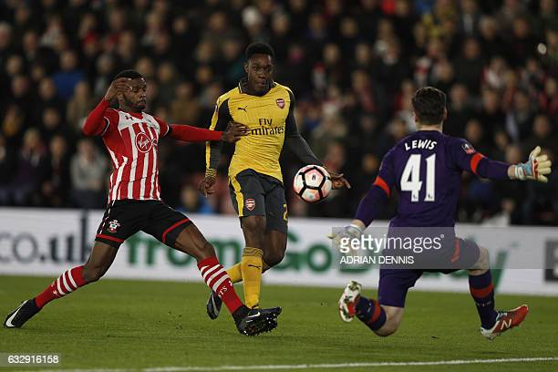 Arsenal's English striker Danny Welbeck scores their first goal during the English FA Cup fourth round football match between Southampton and Arsenal...