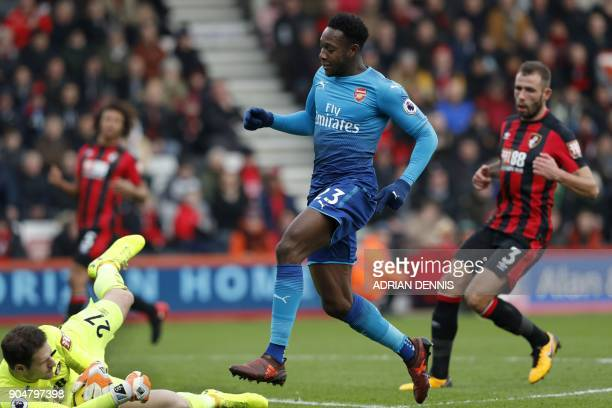 Arsenal's English striker Danny Welbeck shot is blocked by Bournemouth's BosnianHerzegovinian goalkeeper Asmir Begovic during the English Premier...