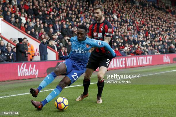 Arsenal's English striker Danny Welbeck vies with Bournemouth's English defender Simon Francis during the English Premier League football match...