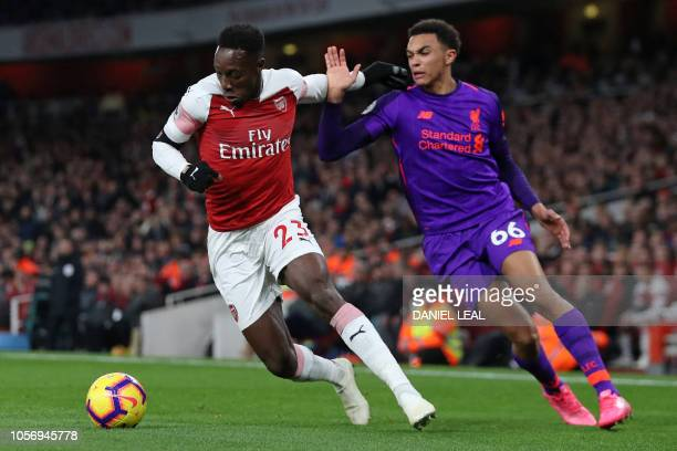 TOPSHOT Arsenal's English striker Danny Welbeck vies with Liverpool's English defender Trent AlexanderArnold during the English Premier League...