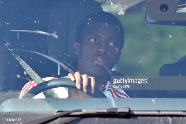 Arsenal's English striker Eddie Nketiah arrives at Arsenal's Colney training centre north of London on May 20 2020 as training continues for Premier...