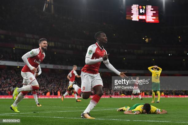 Arsenal's English striker Eddie Nketiah celebrates scoring his team's first goal during the English League Cup fourth round football match between...