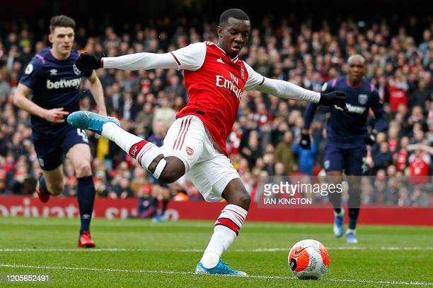Arsenal's English striker Eddie Nketiah crosses the ball during the English Premier League football match between Arsenal and West Ham at the...