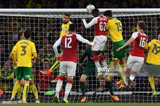 Arsenal's English striker Eddie Nketiah heads the ball to scores his team's second goal in the first half of extra time during the English League Cup...