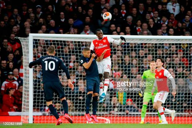 Arsenal's English striker Eddie Nketiah rises above Everton's Brazilian striker Richarlison to make a defensive header during the English Premier...