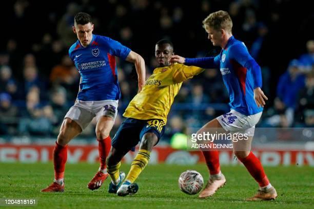 Arsenal's English striker Eddie Nketiah takes on Portsmouth's English defender James Bolton and Portsmouth's English midfielder Cameron McGeehan...