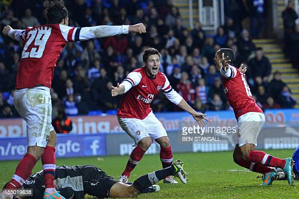 Arsenal's English striker Theo Walcott celebrates scoring Arsenal's sixth goal during extra time in the English League Cup Fourth Round football...