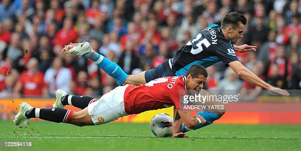 Arsenal's English/Finnish defender Carl Jenkinson fouls Manchester United's Mexican striker Javier Hernandez resulting in a red card for the Arsenal...