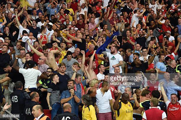 Arsenal's fans celebrate a goal during the UEFA Champions League Group A football match between ParisSaintGermain vs Arsenal FC on September 13 2016...