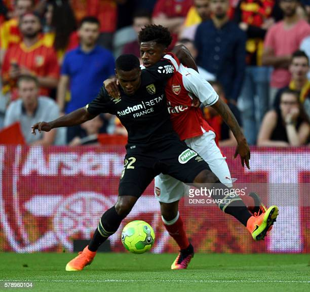 Arsenal's forward Chuba Akpom vies with French Lens's defender Jordan Ikoko during the football match Lens versus Arsenal on July 22 2016 at the...