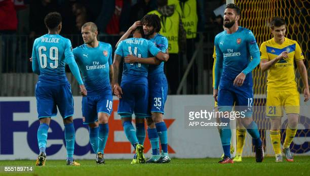 Arsenal's forward from England Theo Walcott celebrates with teammates after scoring a goal during the UEFA Europa League Group H football match...
