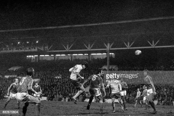 Arsenal's Frank Stapleton heads the winning goal watched by teammates Alan Sunderland and Liam Brady and Nottingham Forest's Archie Gemmill Frank...