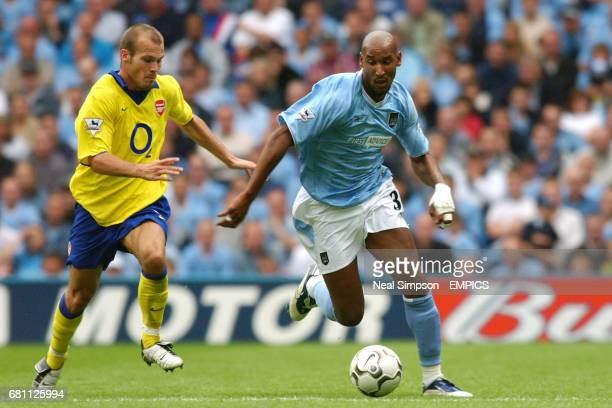 Arsenal's Fredrik Ljungberg and Manchester City's Nicolas Anelka battle for the ball