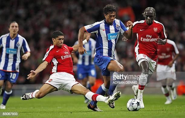 Arsenal's French Bacary Sagna runs back as teammate Arsenal's Brazilian Denilson tackles FC Porto's Freddy Guarin during their UEFA Champions League...