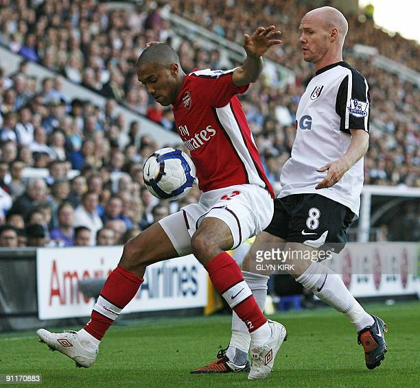 Arsenal's French defender Gael Clichy vies with Fulham's English striker Andrew Johnson during the English Premier League football match between...