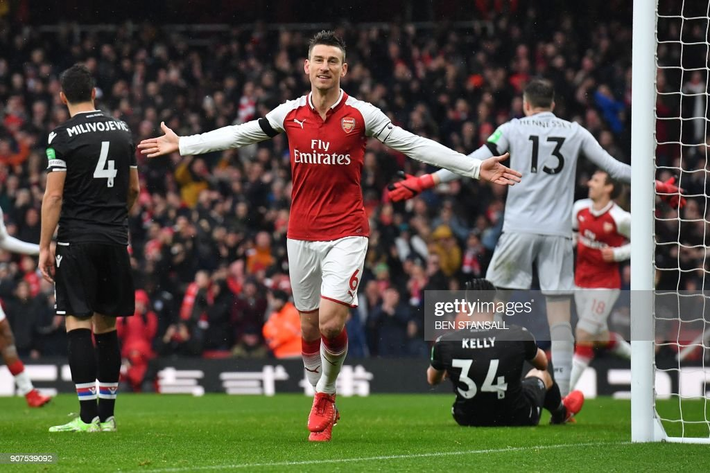 Arsenal's French defender Laurent Koscielny celebrates after scoring their third goal during the English Premier League football match between Arsenal and Crystal Palace at the Emirates Stadium in London on January 20, 2018. / AFP PHOTO / Ben STANSALL / RESTRICTED TO EDITORIAL USE. No use with unauthorized audio, video, data, fixture lists, club/league logos or 'live' services. Online in-match use limited to 75 images, no video emulation. No use in betting, games or single club/league/player publications. /