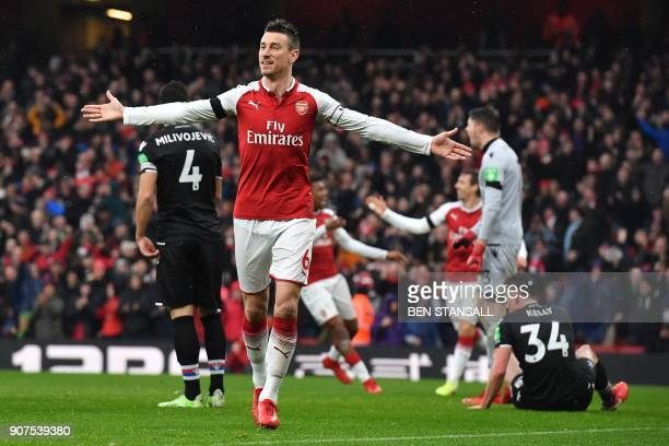 Arsenal's French defender Laurent Koscielny celebrates after scoring their third goal during the English Premier League football match between...