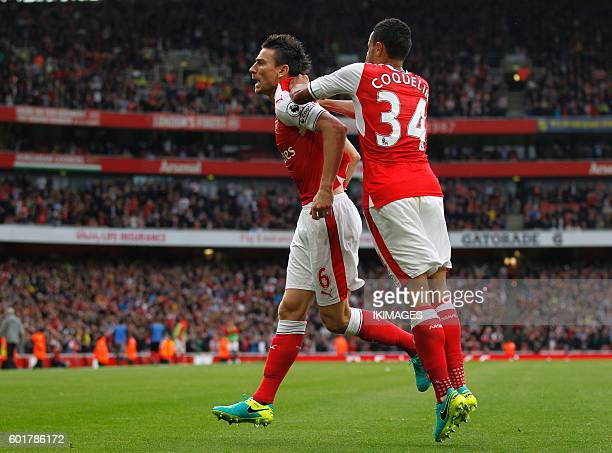 Arsenal's French defender Laurent Koscielny celebrates with Arsenal's French midfielder Francis Coquelin after scoring their first goal with an...