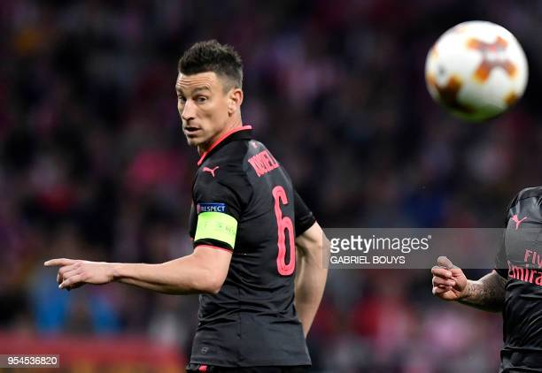 Arsenal's French defender Laurent Koscielny eyes the ball during the UEFA Europa League semifinal second leg football match between Club Atletico de...