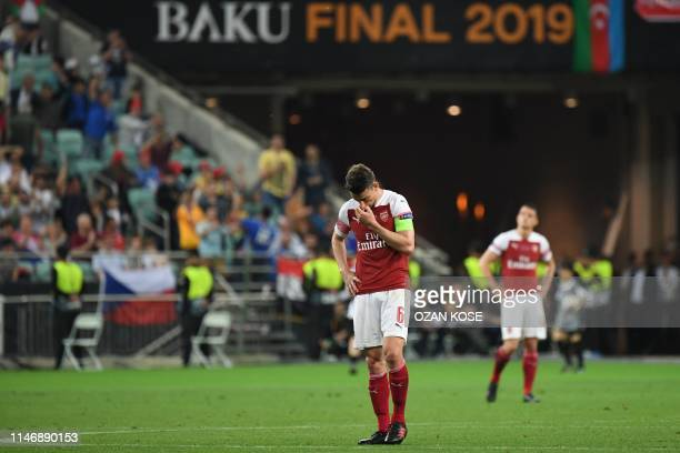 Arsenal's French defender Laurent Koscielny reacts after losing during the UEFA Europa League final football match between Chelsea FC and Arsenal FC...