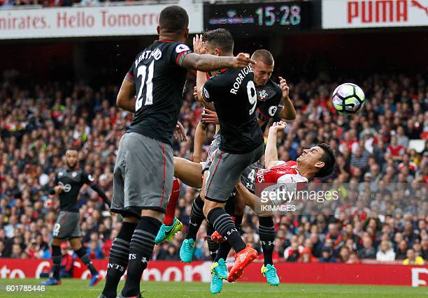 Arsenal's French defender Laurent Koscielny scores their first goal with this overhead kick during the English Premier League football match between...