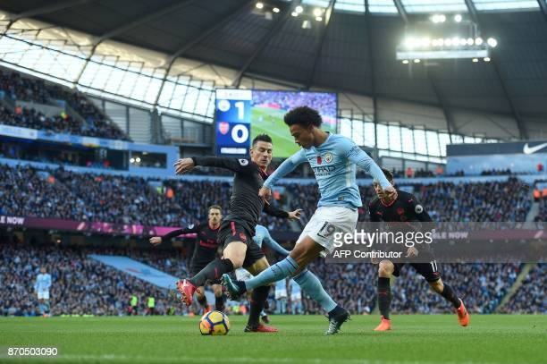 Arsenal's French defender Laurent Koscielny vies with Manchester City's German midfielder Leroy Sane during the English Premier League football match...