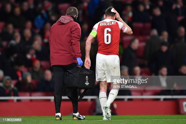 Arsenal's French defender Laurent Koscielny walks away with an injury during the UEFA Europa League quarter final first leg football match between...