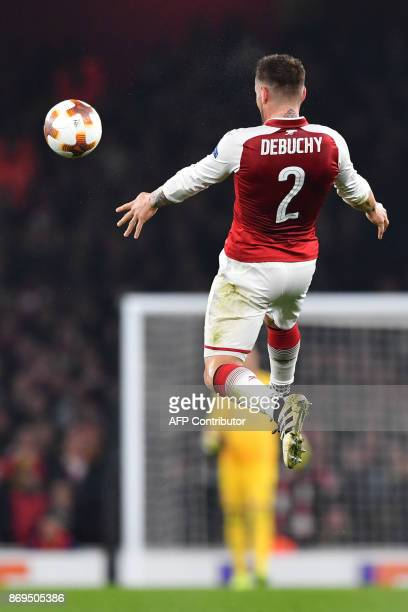 Arsenal's French defender Mathieu Debuchy controls the ball during the UEFA Europa League Group H football match between Arsenal and Red Star...