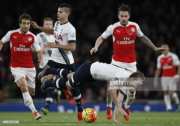 Arsenal's French defender Mathieu Debuchy fouls Tottenham Hotspur's English striker Harry Kane during the English Premier League football match...