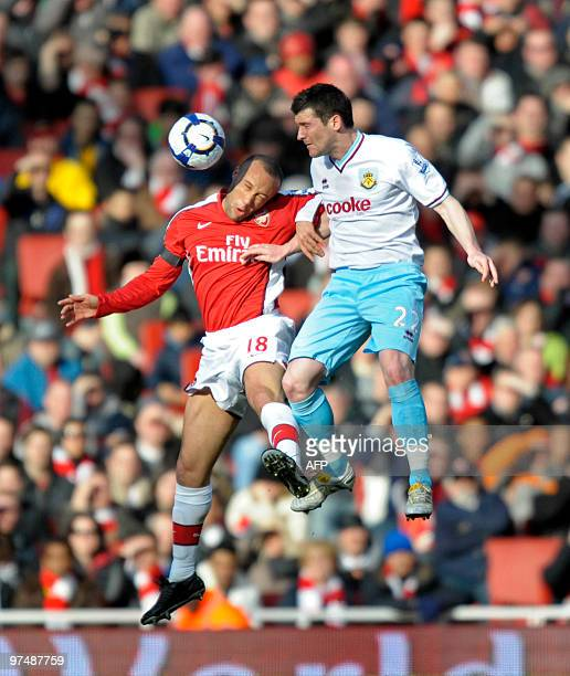 Arsenal's French defender Mikael Silvestre vies with Burnley's English striker David Nugent during the English Premier League football match between...