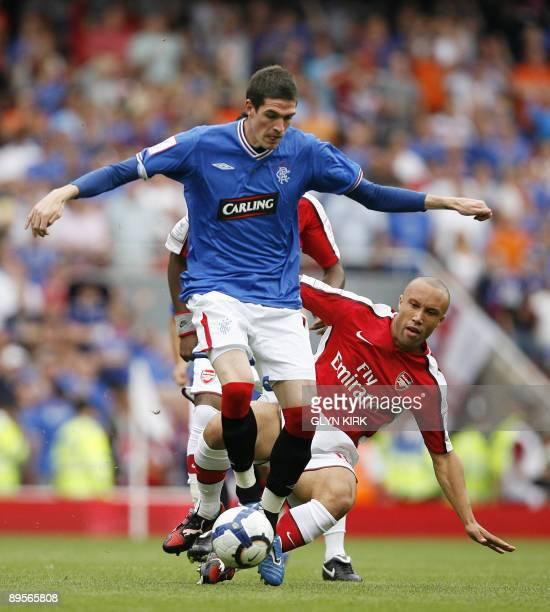 Arsenal's French defender Mikael Silvestre vies with Rangers' Northern Irish striker Kyle Lafferty during the Emirates Cup competition at the...