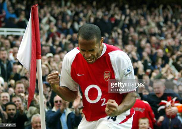 Arsenal's French forward Thierry Henry celebrates his first goal setting up hat trick against Liverpool during their premier league clash at Highbury...