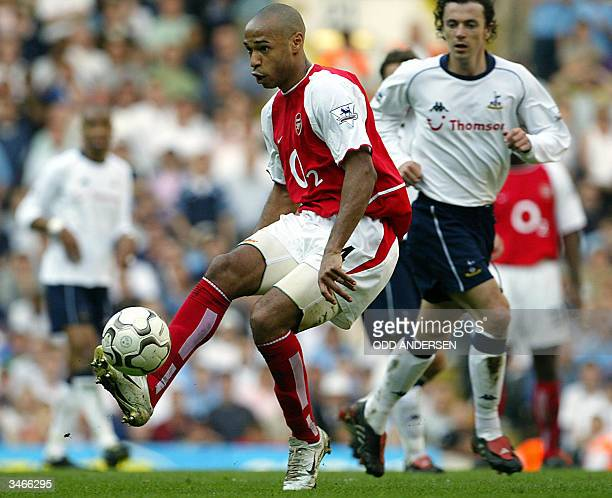 Arsenal's French forward Thierry Henry controls the ball challenged by Simon Davies of Tottenham during their Premier League clash at White Hart Lane...