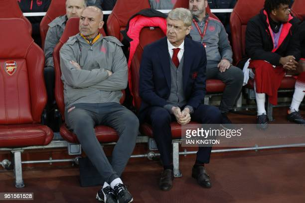 Arsenal's French manager Arsene Wenger and Arsenal's assistant manager Steve Bould await kick off in the UEFA Europa League first leg semifinal...