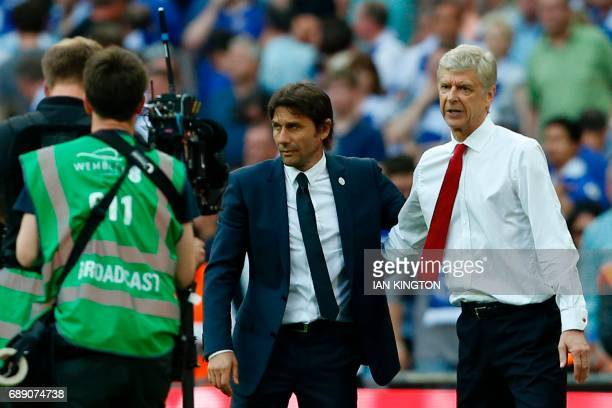 Arsenal's French manager Arsene Wenger and Chelsea's Italian head coach Antonio Conte speak at the final whistle in the English FA Cup final football...