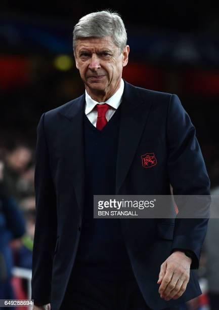 Arsenal's French manager Arsene Wenger arrives for the UEFA Champions League last 16 second leg football match between Arsenal and Bayern Munich at...