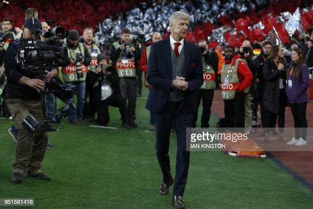 Arsenal's French manager Arsene Wenger arrives for the UEFA Europa League first leg semifinal football match between Arsenal and Atletico Madrid at...