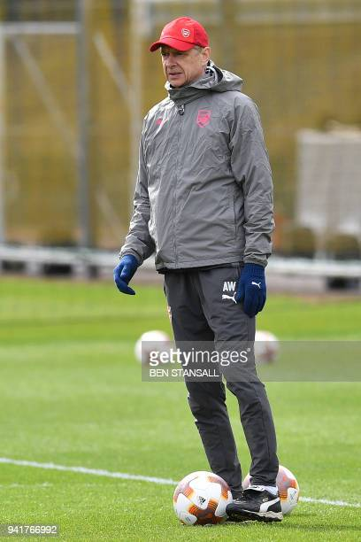 Arsenal's French manager Arsene Wenger attends a training session on the eve of their UEFA Europa League first leg quarter-final football match...