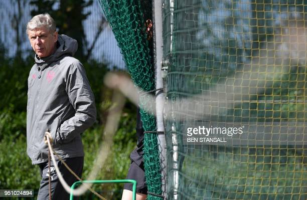Arsenal's French manager Arsene Wenger attends a training session on the eve of their Europa League first leg semifinal football match against...