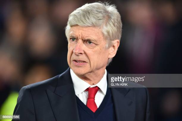 Arsenal's French manager Arsene Wenger awaits kick off in the English Premier League football match between Crystal Palace and Arsenal at Selhurst...