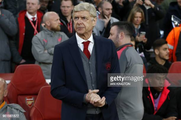 Arsenal's French manager Arsene Wenger awaits kick off in the UEFA Europa League first leg semifinal football match between Arsenal and Atletico...