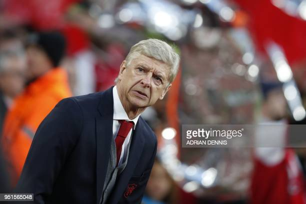 TOPSHOT Arsenal's French manager Arsene Wenger awaits kick off in the UEFA Europa League first leg semifinal football match between Arsenal and...