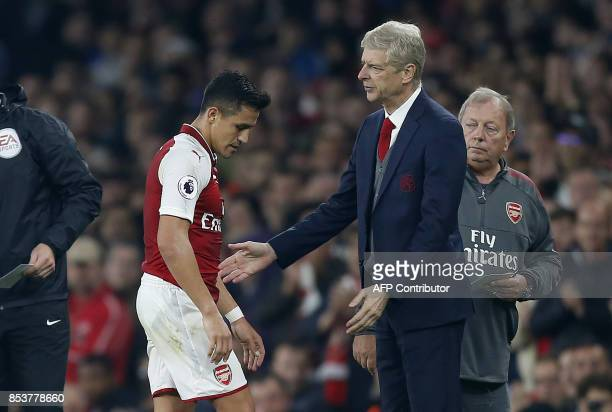 Arsenal's French manager Arsene Wenger gestures as Arsenal's Chilean striker Alexis Sanchez is substituted off of the pitch during the English...