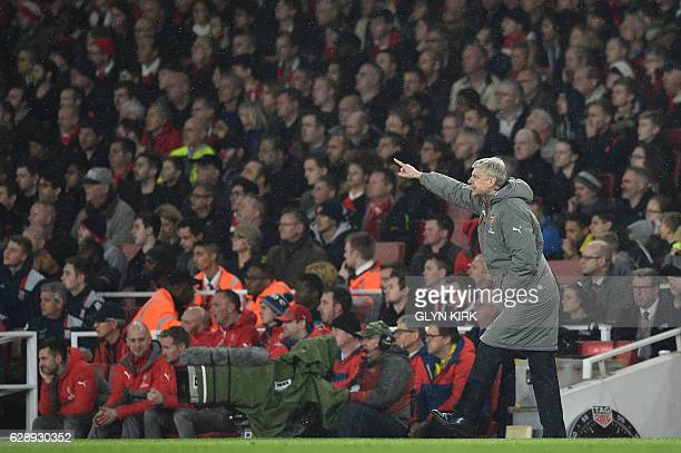 Arsenal's French manager Arsene Wenger gestures during the English Premier League football match between Arsenal and Stoke City at the Emirates...