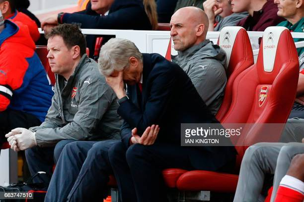 Arsenal's French manager Arsene Wenger gestures during the English Premier League football match between Arsenal and Manchester City at The Emirates...